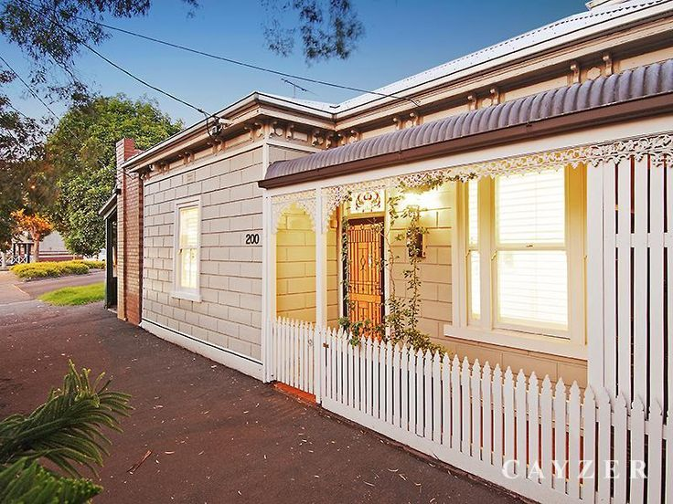 Beige and white Victorian house with red roof. 200 Pickles Street, South Melbourne, Vic 3205