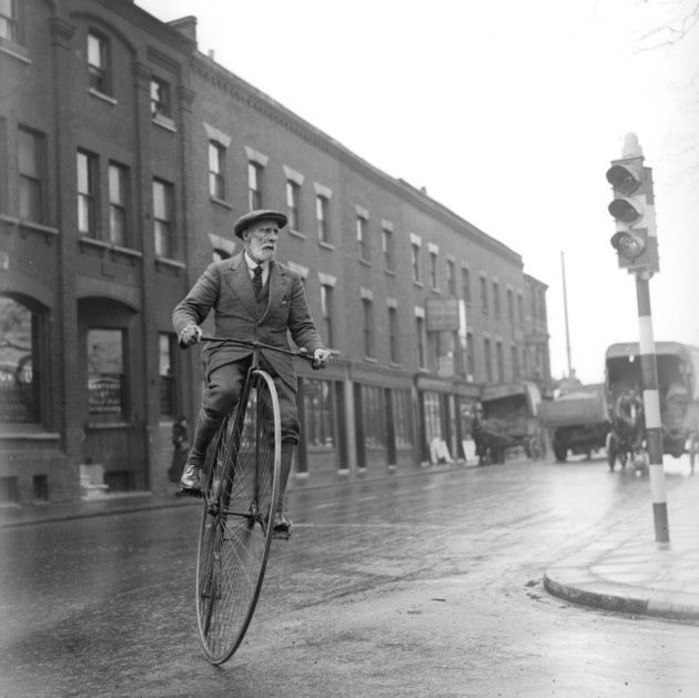 30th April 1934: 70 year old Mark Hill riding his 45 year old pennyfarthing bicycle in Battersea (Photo by William Vanderson/Fox Photos/Getty Images)