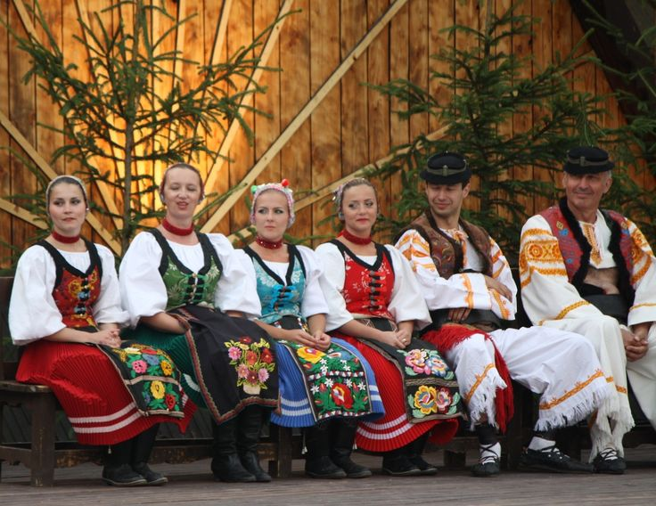 Women wear female folk costumes from village Šumiac (Horehronie region), men wear male folk costumes from village Očová (Podpoľanie region), both from Central Slovakia.