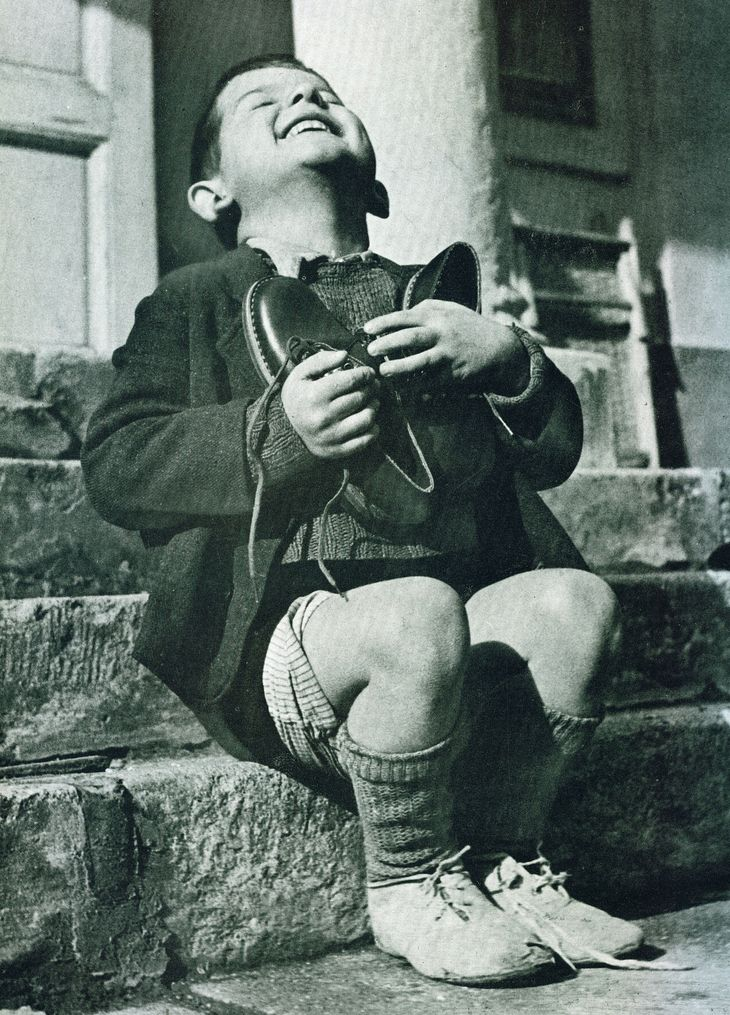 the joy of receiving a pair of shoes, 1947, following WWII