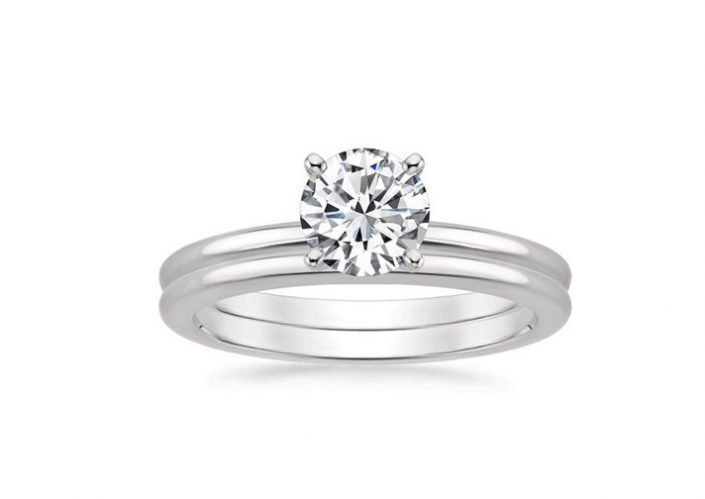 ''Amelia'' Four Prong Petite Comfort fit Matched Diamond Engagement Ring Set This classic petite matched set features a traditional four-prong engagement setting with a matching wedding ring.  Both rings have a rounded inside edge for increased comfort.