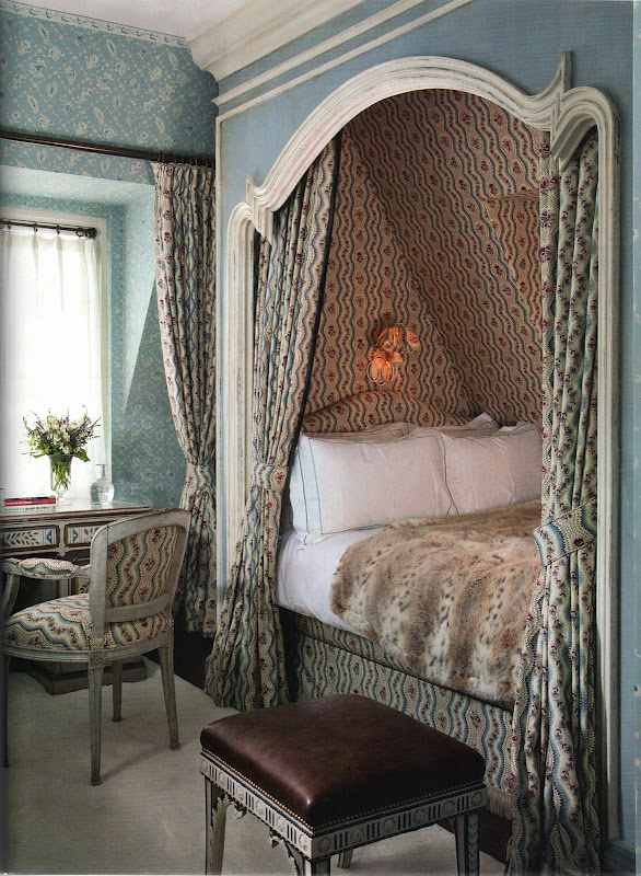 Cozy bed tucked into an alcove - Nicholas Haslam for a London home