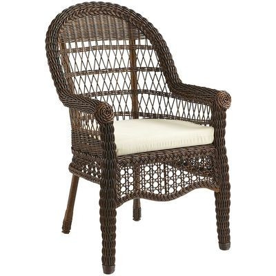 An airy, exceptionally comfy, traditional outdoor dining chair made of hand-woven synthetic rattan over a durable, durable rust-resistant metal frame. To clean, you literally just hose it off. Pretty delicious, huh? Cushion sold separately.