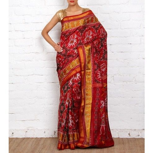 This is a maroon handwoven single Ikat Patola saree in pure silk featuring elephant and tiger patterns on the palla and traditional Patola patterns on the border. The saree has zari borders with ornam