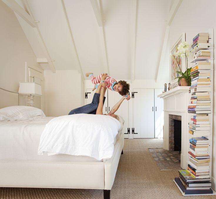 Antique lamps flank the Colette bed from Crate & Barrel; the modern bookcase is from West Elm.Spaces, At Home, Arkansas Offering, Barrels, Modern Bookcases, Colette Beds, Master Bedrooms, Country, Arkansas Magazines