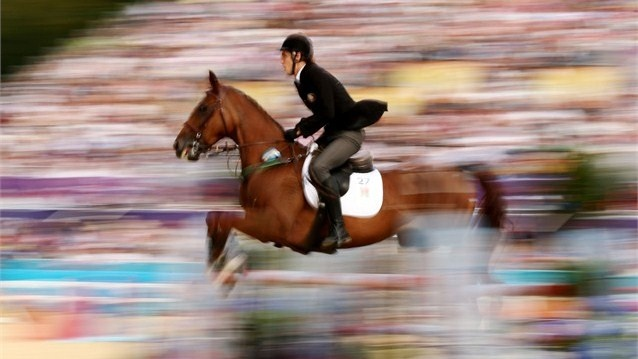 Stanislau Zhurauliou of Belarus riding Amaryllis competes in the Riding Show Jumping during the Men's Modern Pentathlon on Day 15.
