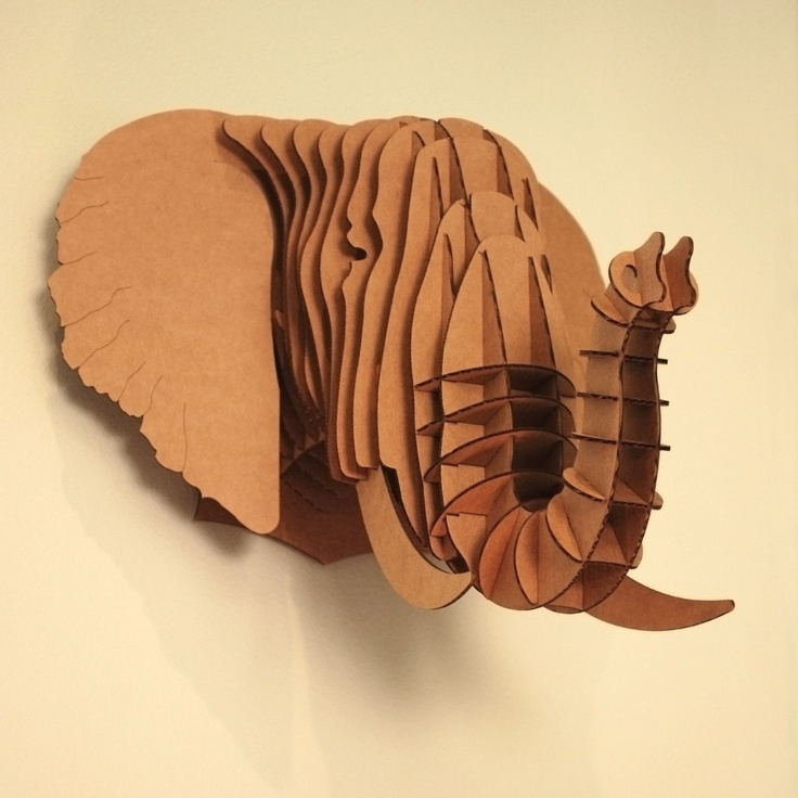 """Ribbed"" cardboard elephant. Pretty easy to cut these pieces with a laser-cutter, I'm told!"