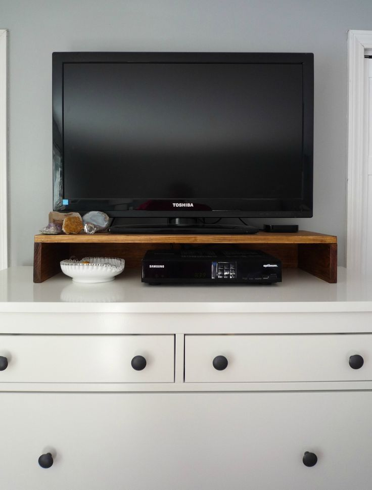 Make a TV stand for the top of your dresser or console to hold cable boxes.