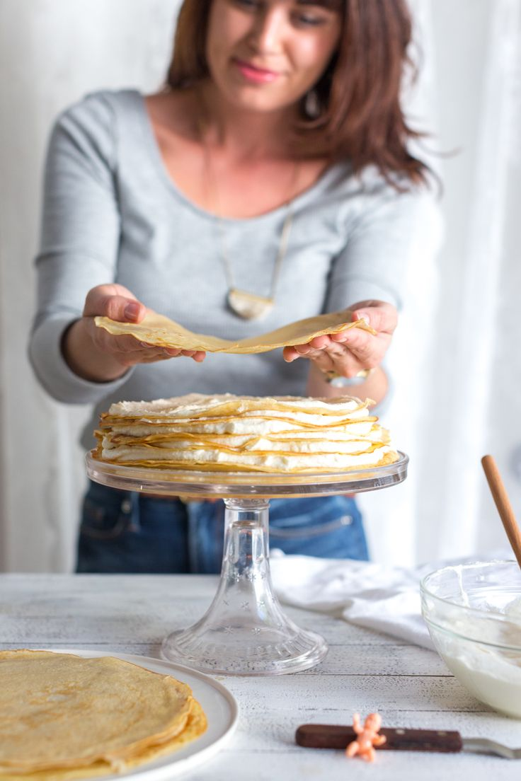 Stacking crepes on Crepe King Cake by Baking The Goods     @beckysuebakes     bakingthegoods.com