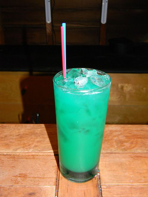 Liquid Marijuana  ½ oz spiced rum ½ oz coconut rum ½ oz Midori ½ oz blue curacao Splash sweet and sour mix 1–2 oz pineapple juice  Place all ingredients except the pineapple juice in a cocktail shaker with ice. Shake and strain into a short glass with ice. Top with pineapple juice. Drink up and enjoy!