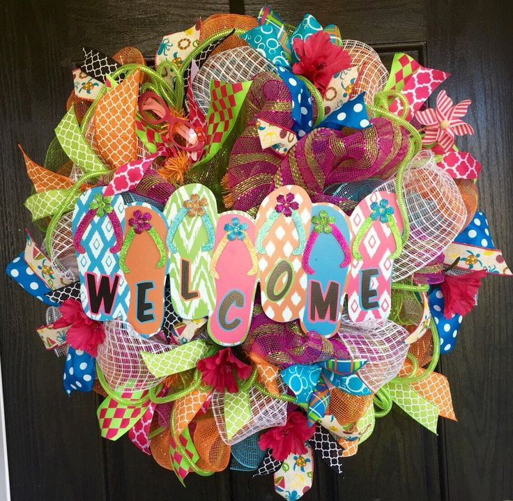 A personal favorite from my Etsy shop https://www.etsy.com/listing/226430502/flip-flop-wreath-summer-deco-mesh-wreath
