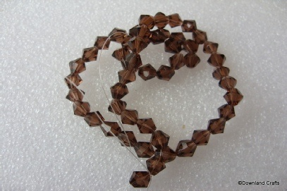 6mm Brown Glass Bicones