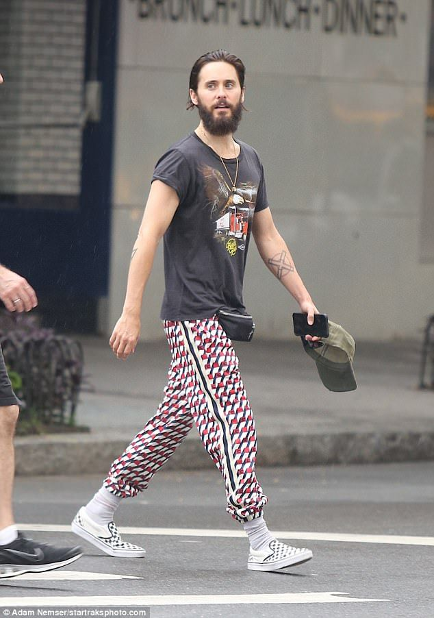Mix and match: The actor wore quirky black, red and white patterned pants tucked into white socks. He added black and white chequered slip-on shoes and a black graphic t-shirt