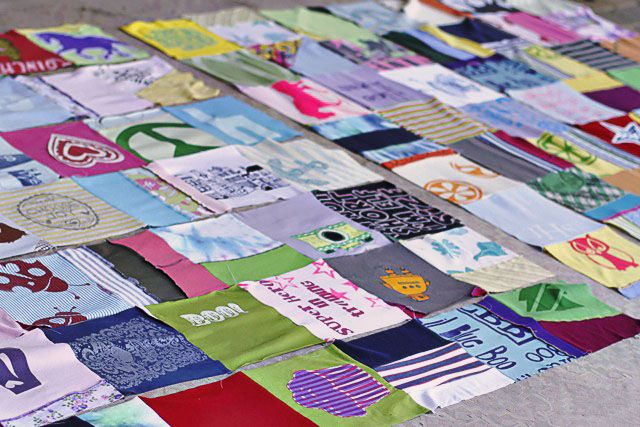 How to make a memory quilt from baby blankets, clothes and t-shirts. DIY tutorial 14 via lilblueboo.com