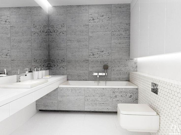 Projekt+jasnej+nowoczesnej+łazienki+z+dużym+lustrem+powiększającym+przestrzeń+i+pojemnymi+szafkami+nad+zabudową+geberitu