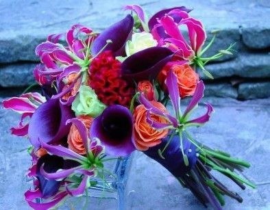 Dark Purple Calla Lilies, Ivory Roses, Red Coxcomb (Celosia), Coral Roses, Purple/Lime Gloriosa Lilies, Hot Pink/Chartreuse Gloriosa Lilies Wedding Bouquet