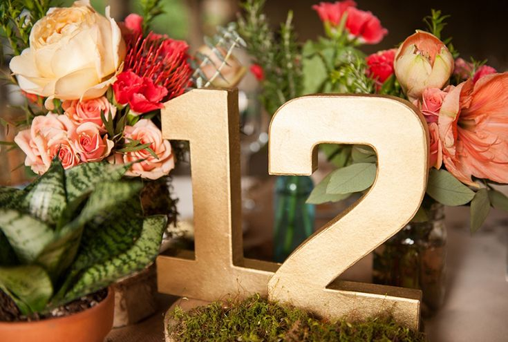 Gold table numbers- LOVE these! // photo by Jennifer Baumann Photography, http://theeverylastdetail.com/2013/10/11/rustic-coral-and-aqua-wedding/