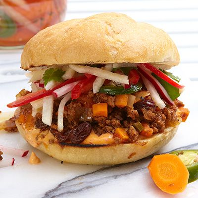 Beef Picadillo Sandwiches with Quick-Pickled Carrots | This flavorful picadillo recipe offers a new twist on a traditional Latin American dish. Dress with Chipotle Mayo and Spicy Slaw, and serve with Quick-Pickled Carrots for a delicious meal.