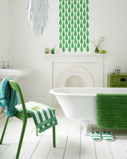 A cool, calm white and green bathroom. Somehow the different shades of green work together.