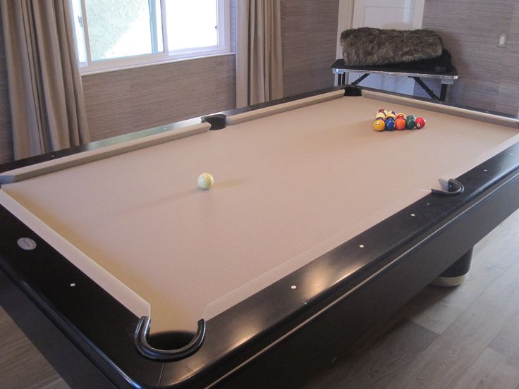Refelt the pool table top for a more neutral look