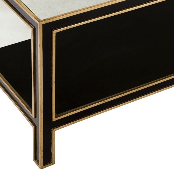 Gorgeous detail of this black and gold mid century style coffee table.  Discover more: