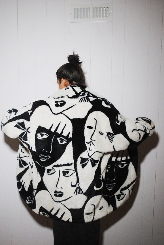 *.* Outrageous 80s oversized winter coat with a front and back pattern of abstract Art Deco black and white mens and womens faces. Faux fur exterior,
