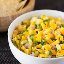 Mango-Pineapple Salsa 1 ripe mango, peeled, cored and diced small (about 2 cups)  1 cup diced pineapple  ½ cup minced red onion  1 jalapeno pepper, seeded and minced  3 tablespoons lime juice  3 tablespoons chopped cilantro  Salt, to taste