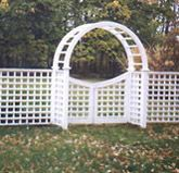 wood arbor with a gate square lattice by elyria fence
