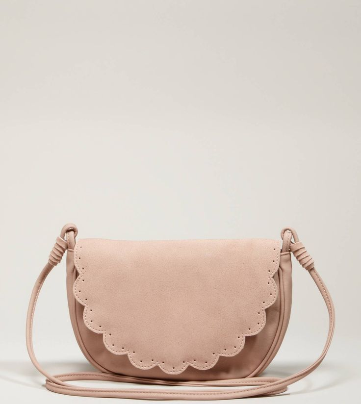 """AEO Scalloped Crossbody Bag in blush    Visual interest.  Polyurethane        • Soft faux leather      • Scalloped front flap      • Perforated details      • Long crossbody strap      • Concealed snap closure         • Interior patch pocket      • Lined      • 9.5""""L x 7""""H x 2""""D"""