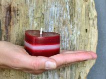 Red and white heart shaped beeswax candle