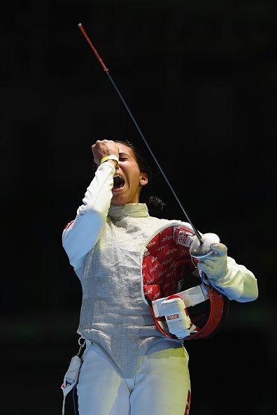 #RIO2016 Ines Boubakri of Tunisia celebrates victory over Eleanor Harvey of Canada during the women's individual foil quarterfinal on Day 5 of the Rio 2016...