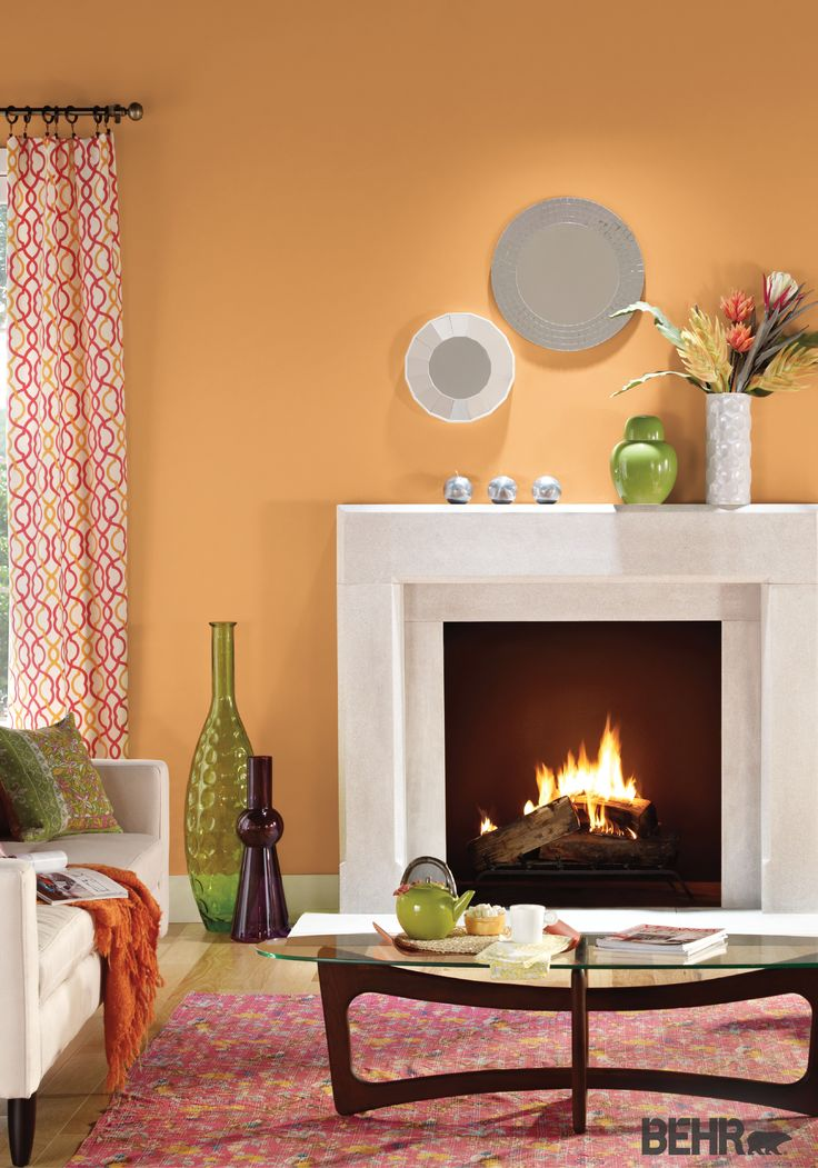 Behr paint in cheerful tangerine makes the base for this colorful living room design to Colors to paint rooms