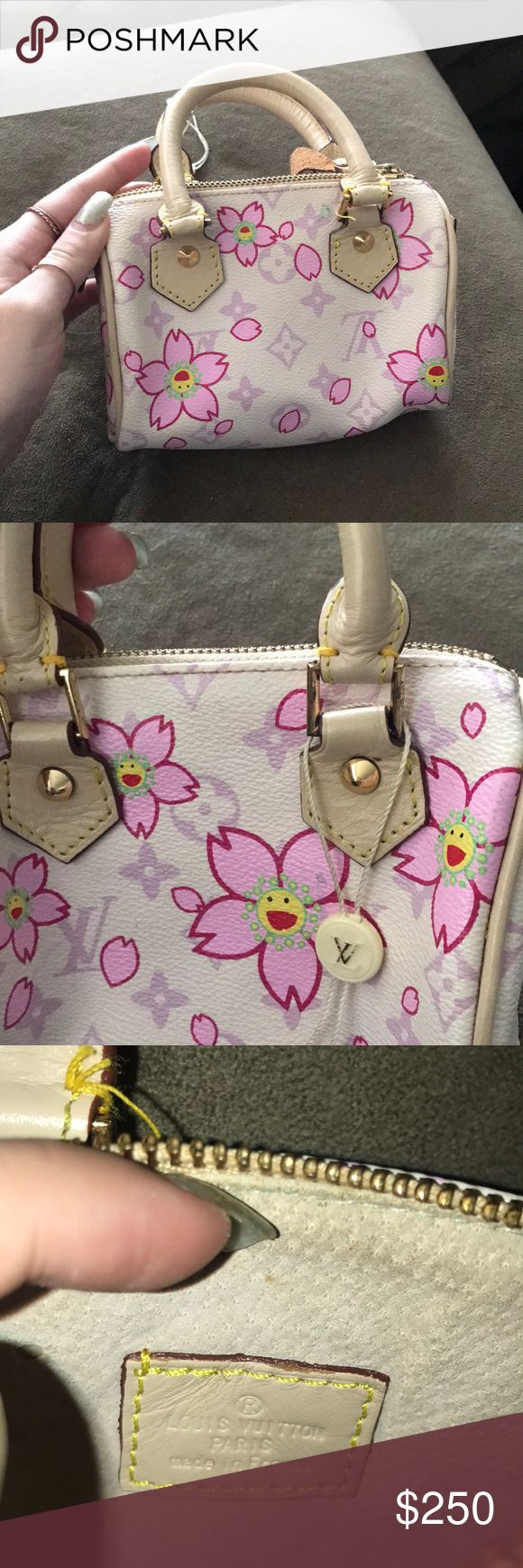 Small Louis Vuitton handbag Cherry Blossom collection 2003 discontinued, so bag is limited edition!! Never used, authenticity tag still attached. Slight fold in leather flap on one side from being stored, otherwise in perfect condition Louis Vuitton Bags Mini Bags
