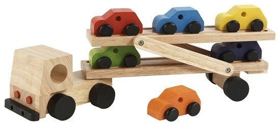 Houten oplegger met 6 voertuigen *** Deze houten autotransportwagen is gemaakt van rubberhout. De vrachtwagen wordt geleverd inclusief 6 autootjes. De autootjes van de autotransportwagen hebben verschillende kleuren waardoor het speelgoed een nog vrolijkere uitstraling krijgt. Het boven dek van de autotransportwagen kan bewegen waardoor de autootjes er gemakkelijk op- en af kunnen rijden. Uw kind zal veel speelplezier beleven aan deze autotransportwagen.