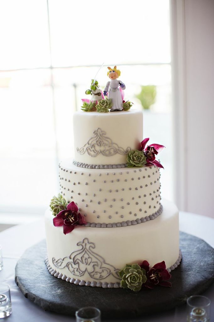 A white wedding cake with a silver