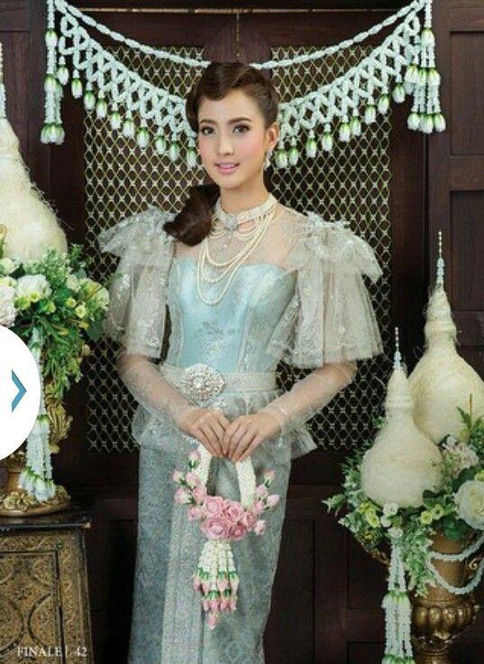 Taew Natapohn in a Blue Traditional Thai Dress
