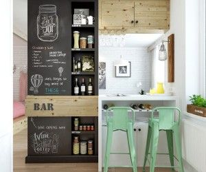 A bar area has been devised as the dividing wall between the lounge and kitchen areas, complete with quirky blackboard feature wall and flip...