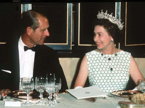 1960's: Dinner. Queen Elizabeth II (Elizabeth Alexandra Mary) (1926-living2013) UK & Prince Phillip Duke of Edinburgh (Philip Mountbatten, born Prince Philip of Greece) (1921-living2013) Greece, 1960's, by unknown artist.