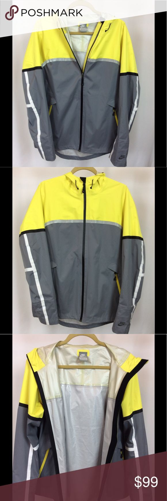 "Nike Sportswear Libero Storm Fit Jacket Men's Nike Sportswear Libero Storm Fit Jacket in Grey and Volt. Size medium; 21"" width, 27.5"" length (longer in back). 100% polyester. Storm-fit 10 seamsealed fabric completely blocks wind and rain penetration at up to 10,000mm of water pressure. Hooded with waist adjusters. Zip through, two side pockets with zip. 3M reflective stripe across chest and back. Slim fit, lightweight and durable. In excellent condition! Nike Jackets & Coats Performance…"