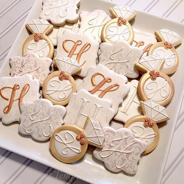 Elegant bridal shower cookies in white, gold pearl and pink champagne. Classic. #BridalShowerCookies #decoratedsugarcookies #monograms #SweetTemptationsByNicole