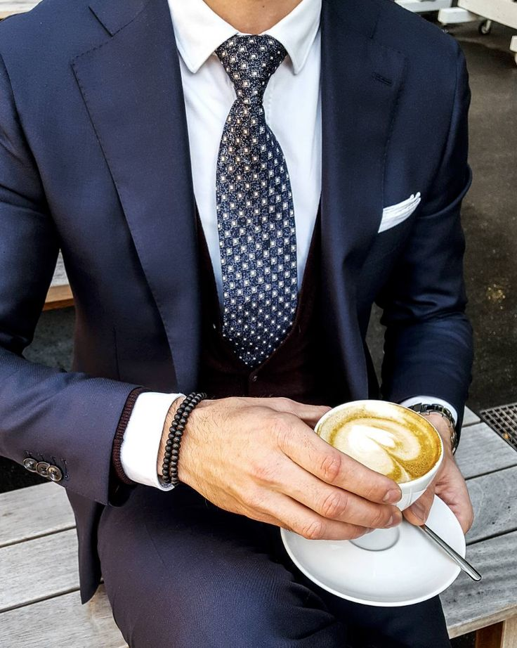 Latte style with a vintage wool tie and navy blue suit.