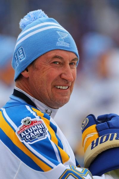 Wayne Gretzky Photos Photos - Wayne Gretzky #99 of the St. Louis Blues looks on during the pre-game skate prior to playing in the 2017 NHL Winter Classic Alumni Game at Busch Stadium on December 31, 2016 in St. Louis, Missouri. - 2017 Bridgestone NHL Winter Classic - Alumni Game