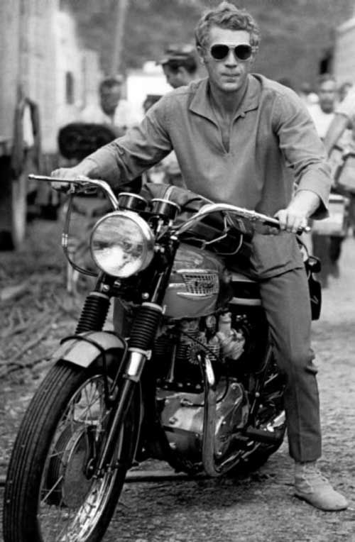 Steve McQueen and his Triumph Bonneville. Yup, they don't make 'em like they used to...#Motorcycle #boots #fashion At Eagle Ages we love Motrocycle boots. You can find a great choice of second hands & vintage Motorcycle boots in our store. https://eagleages.com/shoes/boots/men-boots/motorcycle-boots.html