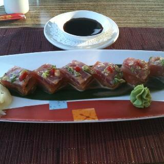 Four layer sashimi: tuna, yellowtail, salmon & wahoo. Some of the best sushi I've had at Harbourfront Restaurant in Hamilton, Bermuda. #bermudarestaurants #sushi