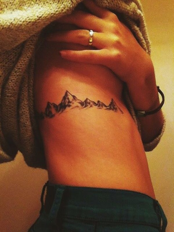 40 Perfectly Placed Rib Tattoo Designs for Girls | http://www.barneyfrank.net/perfectly-placed-rib-tattoo-designs-girls/