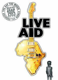 """Live Aid was a dual-venue concert that was held on 13 July 1985. The event was organized by Bob Geldof and Midge Ure to raise funds for relief of the ongoing Ethiopian famine. Billed as the """"global jukebox"""", the event was held simultaneously in Wembley Stadium in London, England (attended by 72,000 people) and John F. Kennedy Stadium in Philadelphia, PA (attended by about 100,000 people)."""