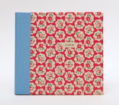 Provence Roses Red with spiral-bound.  Scrapbookers, journalers, and collagers can preserve precious memories with this keepsake album's quality Kraft paper pages, cheerfully designed stickers and labels, and storage pocket.