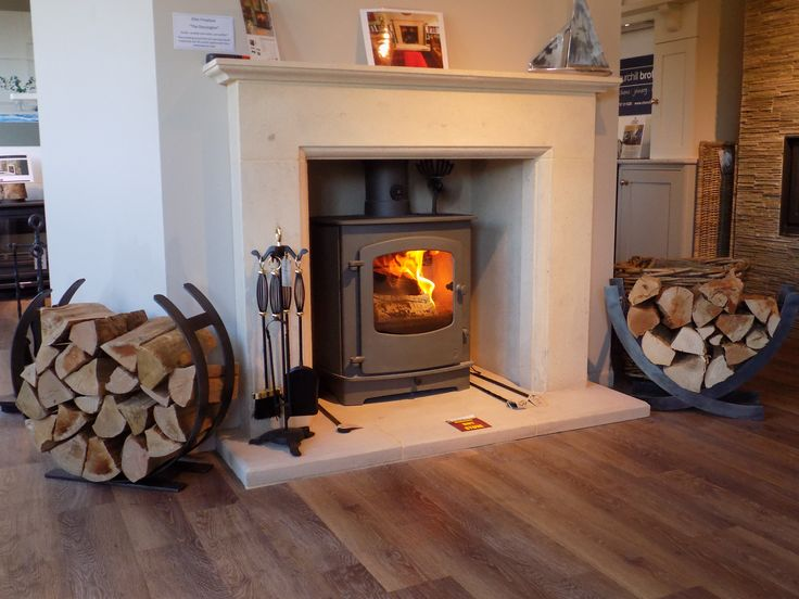 Colnestoves.Elite Dorsington and hearth fireplace with Charnwood Cove 2 stove in gunmetal. Our new hand crafted steel log holders guarding either side. 01284 388188. Visit our showroom with ample free parking. http://www.charnwood.com/where-to-buy.aspx