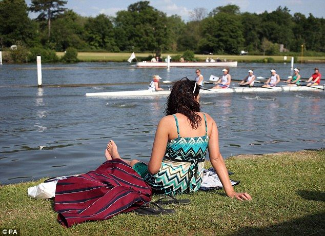 Fun in the sun: A female spectator enjoys the warm weather during day three of the Royal Henley Regatta on the Thames today