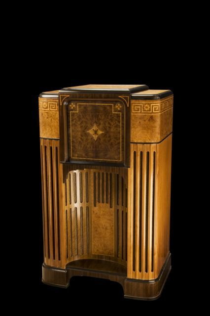 Simply put, the Zenith Stratosphere model 1000Z is one of the most beautiful and unique radios ever designed and produced. This radio, with its $750 price tag, marked the pinnacle of radio opulence during the Great Depression. Its tall skyscraper-like deco cabinet is decorated with rare exotic woods with stunning inlay design patterns that make the cabinet a work-of-art.